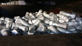 Group of Hex Bolts. A close up click of group of Hex bolts made up of strong steel metal alloy randomly placed in a metal bin stock images