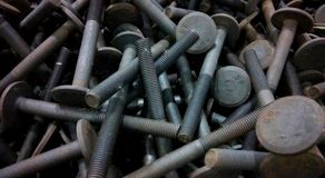 Group of metal screws. A close up click of industrial solid alloy screws stock photography