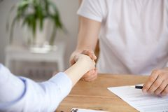 Close up of client handshake realtor buying or renting house. Close up of women shake hand of real estate agent buying house and signing contract, client royalty free stock photos