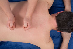 Close-up of a client's back being massaged at spa center Royalty Free Stock Images