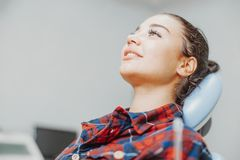 Close up of client smiling while waiting for a stomatologist at dental office stock photo
