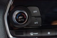 Climate control unit in the new car close. Close up climate control panel in the new car stock image