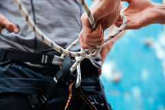 Close-up of climber putting on safety harness climbing equipment Royalty Free Stock Photos