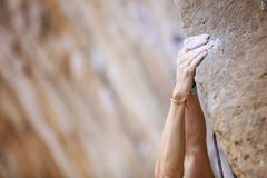 Close up climber's hands. On a cliff Royalty Free Stock Photos