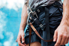 Close-up of climber wearing safety harness and climbing equipment Royalty Free Stock Images