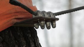 Close-up of climbing carbine on high ropes course in extreme park. stock footage