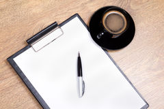 Close up of clipboard, pen and cup of coffee Stock Photo