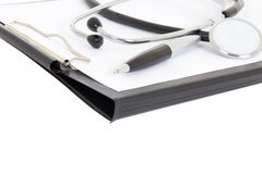 Close up of clipboard, pen and stethoscope isolated on white Stock Image