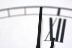 Close-up of a clock. One minute before twelve Royalty Free Stock Photography