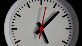 Close-up Clock. Black watch with red arrows Stock Photos