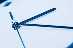 Close-up of clock hands. Toned in blue stock image