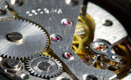 Close-up clock mechanism, shalow dof Stock Photos