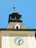 Close up of the clock on the old city hall of Brasov, Romania. Close up of the clock and tower on the old city hall of Brasov, Romania Stock Images