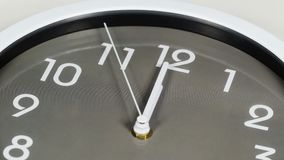 Clock showing at noon. Close up of clock showing at noon stock video footage