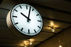Clock in the subway background royalty free stock image