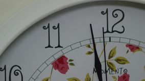 Close up of an clock and the time is almost midnight.  stock video footage