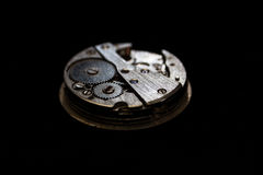 Close-up clockwork on black background.  Royalty Free Stock Photos