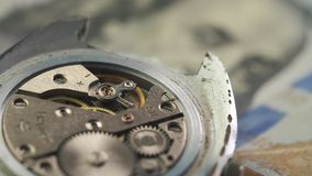 Close up of clockwork drive in a classy watch on the dollar banknote. Close up of clockwork drive in a classy watch on the dollar banknote stock footage