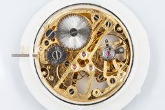 Clockwork mechanism of a pocket watch in gold, with jewels, close-up detail. A close-up of a clockwork mechanism of a pocket watch in gold, with jewels Royalty Free Stock Photos