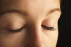 Close-up of closed eyes. Close-up of woman's closed eyes stock photo