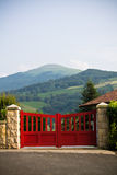 Close up of closed red wooden portal porch in basque country, france Royalty Free Stock Images
