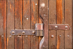 Hinge. Close up of a closed wooden door Royalty Free Stock Photo
