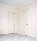 Close up of closed wooden door in the empty room Stock Photography