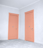 Close up of closed wooden door in the empty room Royalty Free Stock Image