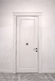 Close up of closed wooden door in the empty room Stock Photo