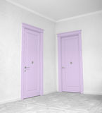 Close up of closed wooden door in the empty room Stock Images