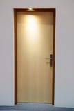 Closed wooden door in low light Stock Image