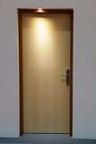 Closed wooden door in low light Royalty Free Stock Photos