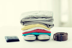 Close up of clothes and accessories on table Royalty Free Stock Photos