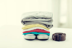 Close up of clothes and accessories on table Royalty Free Stock Photo