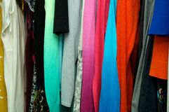 Close up of clothing hanging in closet Royalty Free Stock Photos