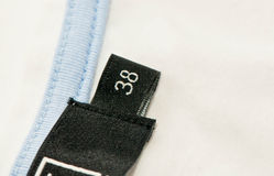 Close-up of clothing label. With size 38 Stock Photography