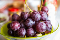 Bunch of tasty red grapes on a plate Stock Photos