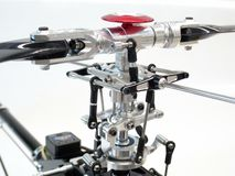 Close-up CNC Aluminium Main Rotor Head for radio-controlled helicopter. royalty free stock photography