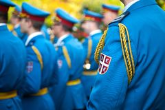 Close up on the coat of Arms of the Serbian army on a soldiers formal uniform during a ceremony in the Belgrade French Embassy. Royalty Free Stock Photography