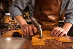 Close up of a cobbler working with leather Royalty Free Stock Photos