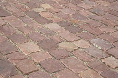 Close up of cobblestone pavement background Royalty Free Stock Photos