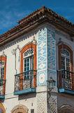 Close-up of cobblestone street with old houses under blue sunny sky in Paraty. Close-up of cobblestone street with old houses under blue sunny sky in Paraty, an Royalty Free Stock Photo