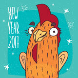 Close-up of cock or rooster stands and smiles. Close-up of cartoon playful cock or rooster stands and smiles on blue background. New Year 2017 lettering Stock Images