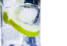 Close-up of cocktail glass with ice and lime slice isolated and space for text Stock Images