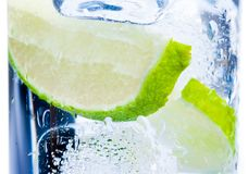 Close-up of cocktail glass with ice and lime slice isolated Stock Photos