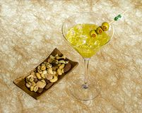 Close-up of cocktail martini with olives on table against Royalty Free Stock Images