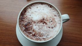 Close up of cocoa cup on the table. Close up of a cocoa cup with milk on the table stock footage