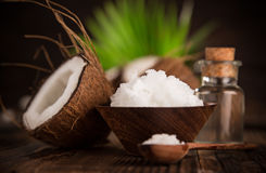 Close-up of a coconut oil. On old wooden background Royalty Free Stock Image
