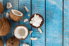 Close-up of a coconut oil. On old wooden background Stock Image