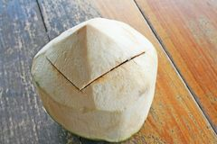 Coconut on wooden table stock images